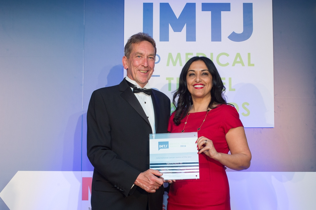 Khadija Mouhajar accepts the Cancer Centre of the Year award from Keith Pollard Chief Editor of IMTJ