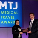 Dr Layla AlMarzouqi of Platinum Sponsor Dubai Health Authority presenting Keith Pollard with an award to show appreciation of Keith's contribution to the medical travel industry.
