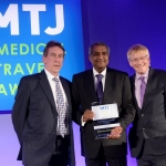 Dato' Dr Jacob Thomas, President of the Association of Private Hospitals of Malaysia collecting the Sanjiv Malik Lifetime Award on behalf of Mr. Josef Woodman